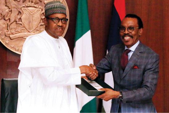 Buhari signs new minimum wage bill